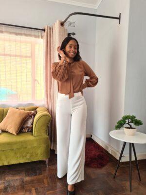 Model wearing widw leg pants in Boutique